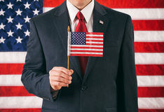 Politician: Man Holding Small USA Flag On Stick stock images