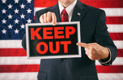Politician: Man Pointing To Keep Out Sign Royalty Free Stock Images