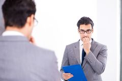 The politician planning speach in front of mirror. Politician planning speach in front of mirror Stock Photography