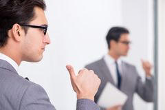 The politician planning speach in front of mirror. Politician planning speach in front of mirror Royalty Free Stock Photography
