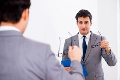 The politician planning speach in front of mirror. Politician planning speach in front of mirror stock photos