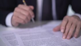 Politician reading and signing important reform document, sand flowing in clock. Stock footage stock footage