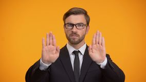 Politician showing stop gesture, anti bribery and corruption concept, taxes. Stock footage stock footage