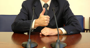 Politician success. Politician demonstrates success with his thumb, concept of businesspeople, success and lifestyles Stock Photography