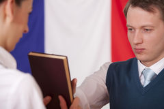 Politician swearing on the bible Stock Photo
