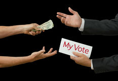 Politician taking bribe for his vote on legislation. Politician taking bribe selling his vote for profit representing bribery, crooked politics, political favors stock images
