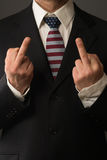 Politician with US colored Tie shows the Finger Royalty Free Stock Images