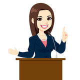 Politician Woman Speech. Young beautiful elegant politician woman giving a speech Stock Photo