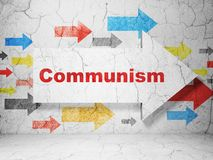 Politics concept: arrow with Communism on grunge wall background Stock Photos