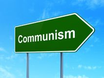 Politics concept: Communism on road sign background Stock Image