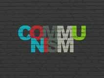 Politics concept: Communism on wall background. Politics concept: Painted multicolor text Communism on Black Brick wall background Stock Photography