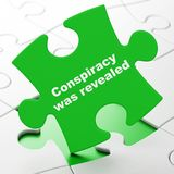 Politics concept: Conspiracy Was Revealed on puzzle background Royalty Free Stock Photos