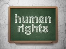 Politics concept: Human Rights on chalkboard background. Politics concept: text Human Rights on Green chalkboard on grunge wall background, 3D rendering Royalty Free Stock Photos
