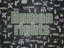 Politics concept: Human Rights on School board background. Politics concept: Chalk Green text Human Rights on School board background with  Hand Drawn Politics Royalty Free Stock Image