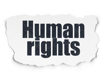 Politics concept: Human Rights on Torn Paper background. Politics concept: Painted black text Human Rights on Torn Paper background with  Tag Cloud Royalty Free Stock Images
