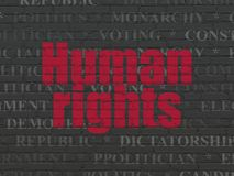 Politics concept: Human Rights on wall background. Politics concept: Painted red text Human Rights on Black Brick wall background with  Tag Cloud Royalty Free Stock Photos