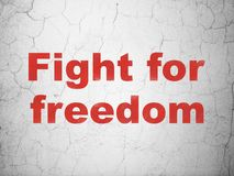 Politics concept: Fight For Freedom on wall background. Politics concept: Red Fight For Freedom on textured concrete wall background Royalty Free Stock Photos