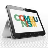 Politics concept: Tablet Computer with Communism on  display Royalty Free Stock Photography
