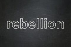 Politics concept: Rebellion on chalkboard background. Politics concept: text Rebellion on Black chalkboard background Royalty Free Stock Photography