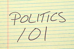 Politics 101 On A Yellow Legal Pad. The words `Politics 101` on a yellow legal pad Stock Photos