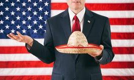 Politicus: De Mexicaanse Sombrero van de mensenholding Stock Foto's