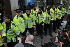 Politie bij de Rel van Londen Stock Afbeeldingen