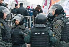 Politie en vergadering Stock Foto