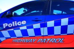 Politie het van letters voorzien op autodeur stock afbeeldingen