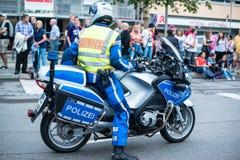 Politie op motor tijdens Christopher Street Day 2014 in Stuttgart Royalty-vrije Stock Foto
