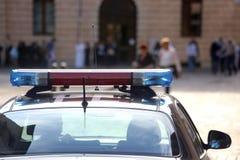 Politie opvlammende sirenes in de stad Stock Afbeelding