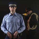 Politieagent en dief. De scène van de diefstal. stock afbeeldingen