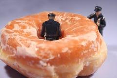 Politieagenten en donuts - komisch Royalty-vrije Stock Afbeelding