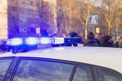 Politieomwenteling op de auto royalty-vrije stock afbeeldingen