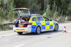 Politiewagen bij autosnelwegongeval of misdaadscène Royalty-vrije Stock Foto's