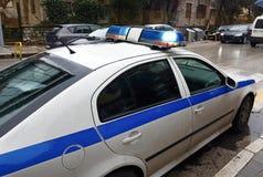 Politiewagen het blauwe lichte knipperen stock afbeeldingen