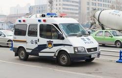 Politiewagen op de weg Royalty-vrije Stock Foto's
