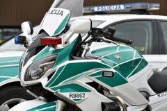 Politiewagens en motorfiets royalty-vrije stock afbeelding