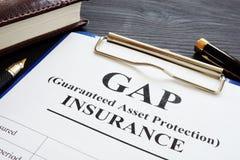 Politik för skydd för tillgång för GAP försäkring garanterad arkivbilder