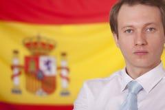 Politiker über spanischer Markierungsfahne stockfotografie