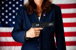 Politiker: Halten von a Gewehr 45 stockfotografie