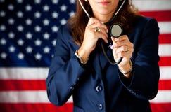 Politiker: Spielen von Doktor mit Stethoskop Lizenzfreie Stockfotografie