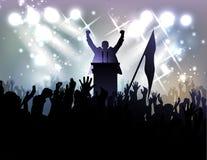 Politiker vor Publikum am Hintergrund mit Scheinwerfern Lizenzfreie Stockbilder