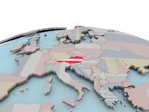 Politische Karte von Österreich auf Kugel mit Flagge Lizenzfreie Stockfotos