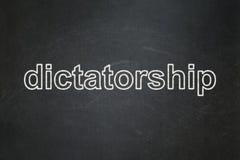 Politiskt begrepp: Diktatur på svart tavlabakgrund stock illustrationer