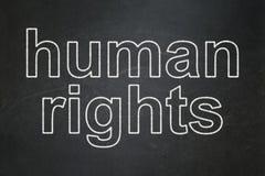 Politiskt begrepp: Mänskliga rättigheter på svart tavlabakgrund royaltyfri illustrationer