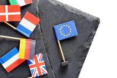 Politiskt begrepp med flaggor av den europeiska unionen Fotografering för Bildbyråer