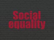 Politiskt begrepp: Social jämställdhet på väggbakgrund arkivfoton