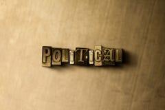 POLITISKT - närbild av det typsatta ordet för grungy tappning på metallbakgrunden Royaltyfria Bilder