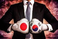Politiskt och affärsidéen av handla kriget mellan Korea och Japan arkivfoto
