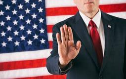 Polityk: Mężczyzna Trzyma Up rękę W przerwy pozie obrazy royalty free